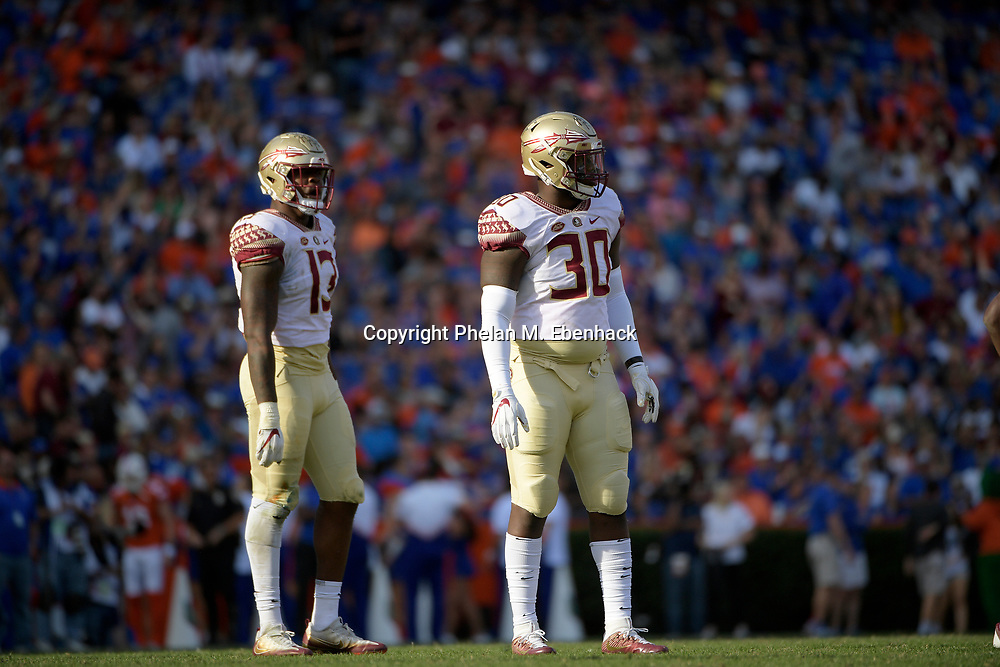 Florida State defensive end Jalen Wilkerson (30) and defensive end Joshua Kaindoh (13) line up for a play during the second half of an NCAA college football game against Florida Saturday, Nov. 25, 2017, in Gainesville, Fla. FSU won 38-22. (Photo by Phelan M. Ebenhack)