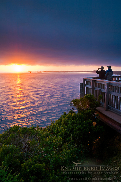People watching the sunset over the ocean from Enderts Beach Overlook, near Crescent City, Redwood National Park, California