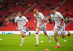 STOKE-ON-TRENT, ENGLAND - Saturday, January 25, 2020: Stoke City's (L-R) Joe Allen, Sam Clucas and Danny Batth during the pre-match warm-up before the Football League Championship match between Stoke City FC and Swansea City FC at the Britannia Stadium. (Pic by David Rawcliffe/Propaganda)