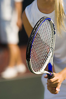 Tennis Player holding racket Waiting For doubles partner to Serve close-up mid section