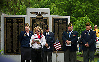 Valerie Johnstone President VFW Auxiliary addresses the crowd gathered at Veteran's Square during Memorial Day services on Monday morning.  (Karen Bobotas/for the Laconia Daily Sun)