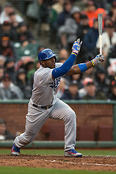 SAN FRANCISCO, CA - APRIL 09:  Yasiel Puig #66 of the Los Angeles Dodgers hits a single against the San Francisco Giants during the ninth inning at AT&T Park on April 9, 2016 in San Francisco, California. The Los Angeles Dodgers defeated the San Francisco Giants 3-2 in 10 innings. (Photo by Jason O. Watson/Getty Images) *** Local Caption *** Yasiel Puig