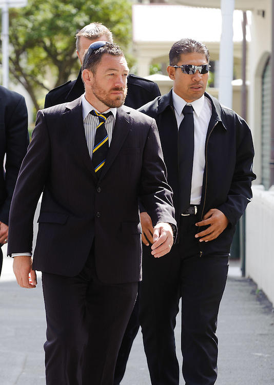 Hurricanes coach Mark Hammett, left and assistant coach Alama Ieremia arrive at Old St Pauls Church for the funeral of Michael James Bowie Hobbs (Jock), former All Black rugby captain, Wellington, New Zealand, Sunday, March 18, 2012. Credit: SNPA / Mark Coote