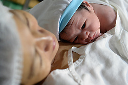 January 1, 2018 - Manila, Philippines - Mishela Lucas, 37, cradles her newborn son Kris Anthony Sarjos at a public hospital in Manila, Philippines,  on 01 January 2018. Kris Anthony was born 12:02am and was the first baby to be born at the hospital this year according to doctors. (Credit Image: © George Calvelo/NurPhoto via ZUMA Press)