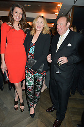 Left to right, OLIVIA COLE, KIM CATTRALL and ANDREW NEIL at the 3rd birthday party for Spectator Life magazine hosted by Andrew Neil and Olivia Cole held at the Belgraves Hotel, 20 Chesham Place, London on 31st March 2015.