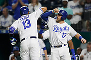 Kansas City Royals' Salvador Perez (13) is congratulated at home plate by Hunter Dozier (17) after hitting a two-run home run in the sixth inning of a baseball game against the Minnesota Twins at Kauffman Stadium in Kansas City, Mo., Thursday, Sept. 13, 2018. (AP Photo/Colin E. Braley)