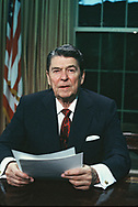 President Ronald Reagan makes an Oval Office address to the nation to announce the bombing of Libya on April 14,1986 Note. This photograph was made in a photographers opportunity after President Reagan completed his live  television address.  Photo by Dennis Brack