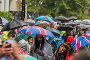 The rain comes but fails to dampen spirits too much - The Sunday of the Notting Hill Carnival. The annual event on the streets of the Royal Borough of Kensington and Chelsea, over the August bank holiday weekend. It is led by members of the British West Indian community, and attracts around one million people annually, making it one of the world's largest street festivals.