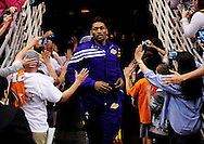 Feb. 19, 2012; Phoenix, AZ, USA;  Los Angeles Lakers forward Metta World Peace (15) runs through the tunnel as fans take photos prior to the first half against the Phoenix Suns at the US Airways Center.  Mandatory Credit: Jennifer Stewart-US PRESSWIRE.