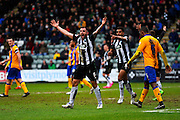 Plymouth Argyle's Peter Hartley appeals for a penalty to the assistant referee during the Sky Bet League 2 match between Plymouth Argyle and Mansfield Town at Home Park, Plymouth, England on 13 February 2016. Photo by Graham Hunt.