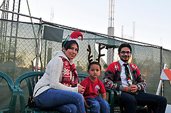 From left, Mariana, Jayden and Juan Lopez are in full holiday attire as they wait by the Taylor construction site in Oldtown for the Parade of Lights to begin.