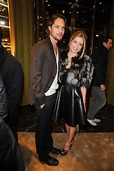 Actress ANNABELLE WALLIS and JAMES ROUSSEAU at a Cocktail party to celebrate the opening of the new Miu Miu boutique, 150 New Bond Street, London hosted by Miuccia Prada and Patrizio Bertelli on 3rd December 2010.