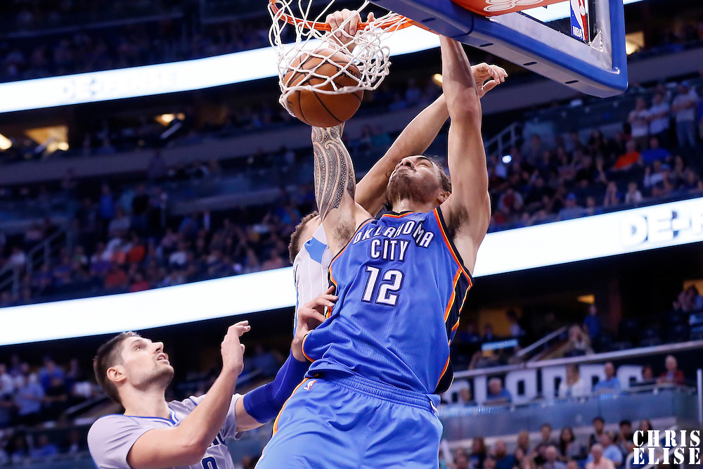 30 October 2015: Oklahoma City Thunder center Steven Adams (12) dunks the ball during the Oklahoma City Thunder 139-136 double overtime victory over the Orlando Magic, at the Amway Center, in Orlando, Florida, USA.
