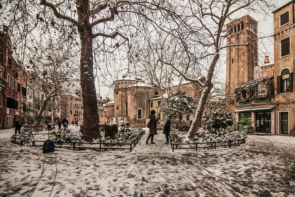 VENICE, ITALY - 28th FEBRUARY/01st MARCH 2018<br /> A mother takes a picture of her son in the snow at Campo San Giacomo da L'Orio during a snowfall in Venice, Italy. A blast of freezing weather called the &ldquo;Beast from the East&rdquo; has gripped most of Europe in the middle of winter of 2018, and in Venice A snowfall has covered the city with white, making it fascinating and poetic for citizen and tourists.   &copy; Simone Padovani / Awakening