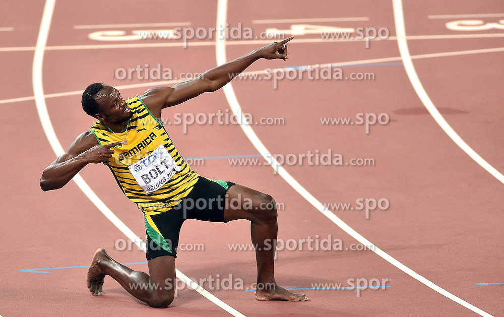 27-08-2015 CHN: IAAF World Championships Athletics day 6, Beijing<br /> Usain Bolt celebrates after winning 200m with time 19.55s