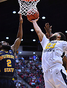 SAN DIEGO, CA - MARCH 16:  Murray State Racers guard Jachai Taylor (23) gets a layup against Murray State Racers guard Jonathan Stark (2) during a first round game of the Men's NCAA Basketball Tournament at Viejas Arena in San Diego, California. West Virginia won 85-68.  (Photo by Sam Wasson)