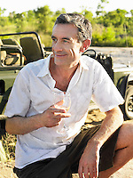 Portrait of adult man holding wineglass outdoors
