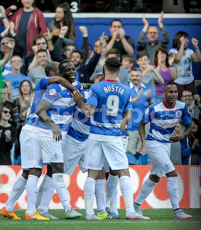 Queens Park Rangers players celebrate Clint Hill of Queens Park Rangers for his goal during the Sky Bet Championship match between Queens Park Rangers and Cardiff City at the Loftus Road Stadium, London, England on 15 August 2015. Photo by Salvio Calabrese.