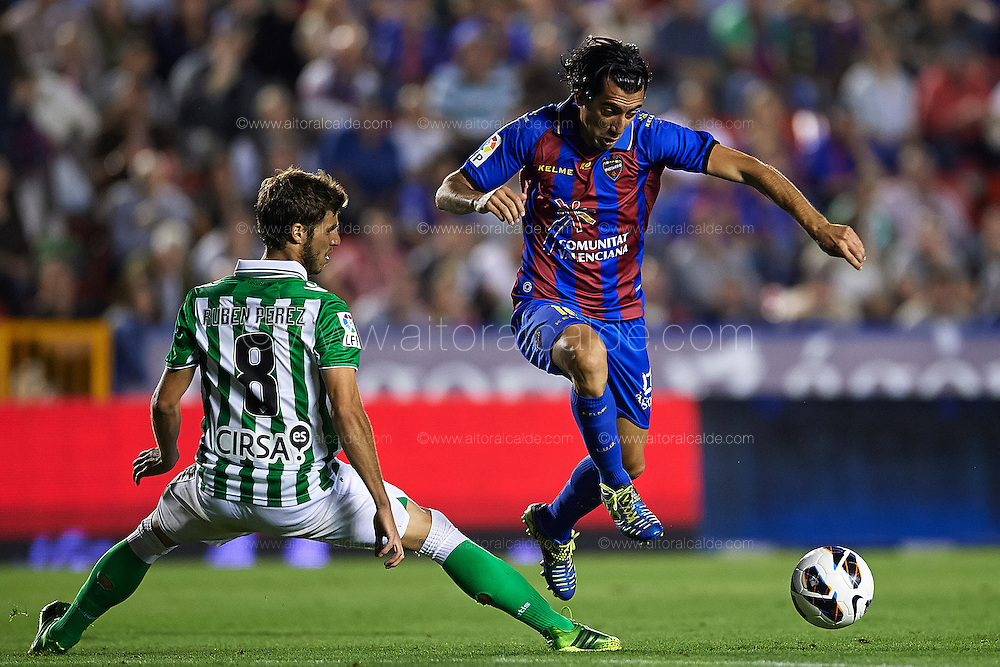 VALENCIA, SPAIN - JUNE 01: (R) Pedro Rios of Levante UD being fouled by (L) Ruben Perez of Real Betis Balompie during the Liga BBVA between Levante UD and Real Betis Balompie at the Ciutat de Valencia stadium on June 01, 2013 in Valencia, Spain. (Photo by Aitor Alcalde Colomer).