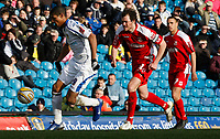Photo: Steve Bond/Richard Lane Photography. Leeds United v Swindon Town. Coca Cola League One. 14/03/2009. Jermaine Beckford heads for goal. Gordon Greer chases