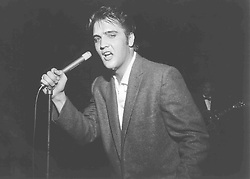 May 15, 1956 - Memphis, TN, U.S. - More than 7,000 people jammed Ellis Auditorium on the night of May 15, 1956, to stomp, shudder, shriek and sigh as a young Elvis Presley writhed his way through a rock and roll repertoire. Presley was the blockbuster of Bob Neal's Cotton Picking Jamboree, a feature of Cotton Carnival opening night. (Credit Image: © The Commercial Appeal/ZUMApress.com)