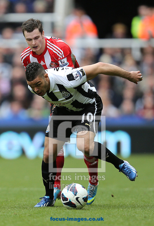 Picture by Paul Gaythorpe/Focus Images Ltd +447771 871632.14/04/2013.Adam Johnson of Sunderland and Hatem Ben Arfa of Newcastle United during the Barclays Premier League match at St. James's Park, Newcastle.