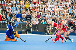 England's Alex Danson scores her 100th goal as she beats Julia Remmerswaal of the The Netherlands. England v The Netherlands, Lee Valley Hockey and Tennis Centre, London, England on 11 June 2017. Photo: Simon Parker