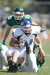 15 September 2007: Jake Davis lands on his tackler, Nick Nikolich. The Titans stood toe to toe with the 25th ranked Lions through the first half but ended the game on the losing end of a 25-15 score at Wilder Field on the campus of Illinois Wesleyan University in Bloomington Illinois.