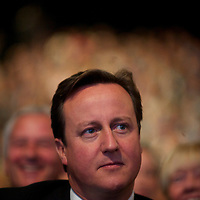 Prime Minister DAVID CAMERON listens to Chancellor of the Exchequer George Osborne address delegates during the Conservatives Party Conference at Manchester Central.