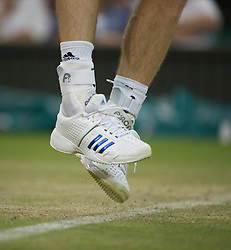 LONDON, ENGLAND - Friday, June 24, 2011: The heavily strapped ankles of Andy Murray (GBR) during Gentlemen's Singles 3rd Round match on day five of the Wimbledon Lawn Tennis Championships at the All England Lawn Tennis and Croquet Club. (Pic by David Rawcliffe/Propaganda)