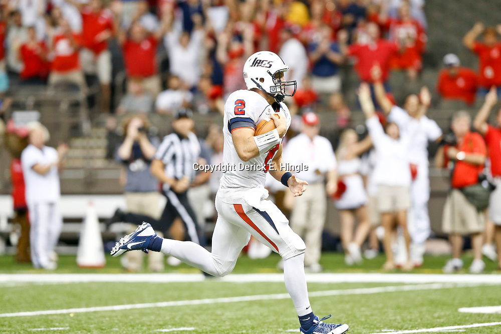 Sep 7, 2013; New Orleans, LA, USA; South Alabama Jaguars quarterback Ross Metheny (2) runs for a touchdown against the Tulane Green Wave during the first quarter of a game at the Mercedes-Benz Superdome. Mandatory Credit: Derick E. Hingle-USA TODAY Sports