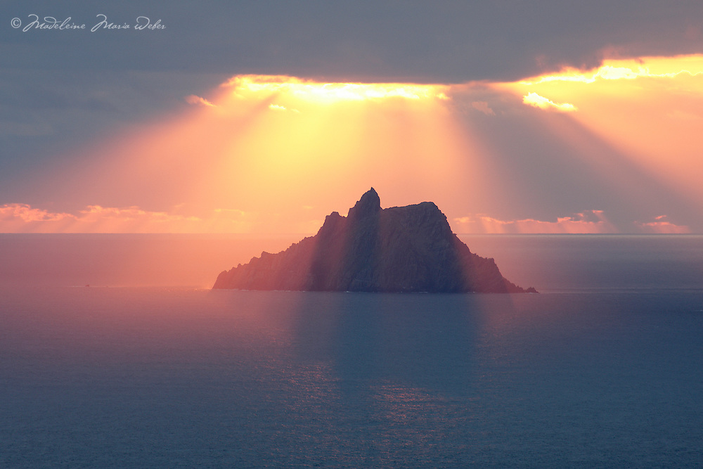 Skellig Michael Blessing<br /> <br /> Sunset at Skellig Michael, County Kerry, Ireland ****** <br /> <br /> Visit &amp; browse through my Photography &amp; Art Gallery, located on the Wild Atlantic Way &amp; Skellig Ring between Waterville and Ballinskelligs (Skellig Coast R567), only 3 minutes from the main Ring of Kerry road.<br /> https://goo.gl/maps/syg6bd3KQtw<br /> <br /> ******<br /> <br /> Contact: 085 7803273 from an Irish mobile phone or +353 85 7803273 from an international mobile phone
