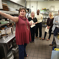Adam Robison | BUY AT PHOTOS.DJOURNAL.COM<br /> Blair Hughes, owner of Park Heights Restaurant, gives a tour of the kitchen area to Chanda Cossitt, Chip Ashford, Gracie Menetre and Wesley Jones, this years celebrity chefs for the Boys and Girls Club Cooking like the Stars fundraiser Tuesday afternoon in Tupelo.