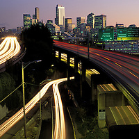 USA, Washington, Seattle, Traffic lights during evening rush hour along I-5 with downtown skyline in background