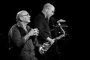 "Saxophonists David Liebman and Jeff Coffin concentrate a solo during their tribute performance to Miles Davis's ""On the Corner"" sessions."
