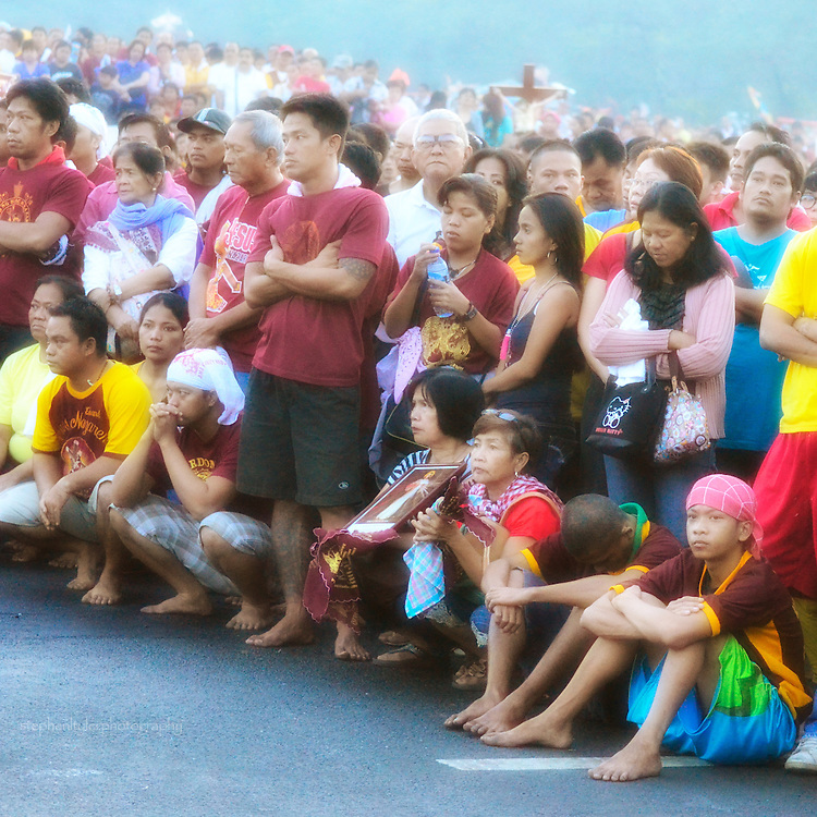 The devotees of the Black Nazarene hold replica images, crosses, and themselves during the ceremony in the early hours before the procession begins.
