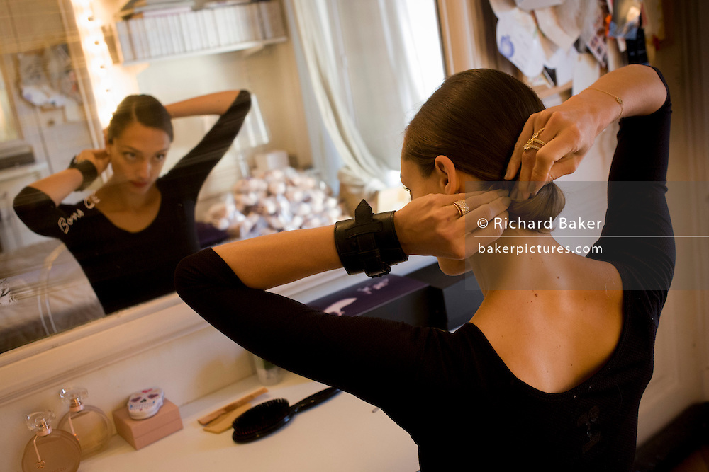Ballerina, Doroth&eacute;e Gilbert readies for her class in her dressing room at the Palais Garnier, Paris. <br /> <br /> From the chapter entitled 'Etoile' and from the book 'Risk Wise: Nine Everyday Adventures' by Polly Morland (Allianz, The School of Life, Profile Books, 2015). <br /> <br /> FOR REPRODUCTION OTHER THAN RELATED TO THE BOOK 'RISK WISE', PERMISSION FROM DOROTHEE GILBERT IS REQUIRED.