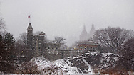 Belvedere Castle in a blizzard with the outlines of the twin towers of the San Remo apartment building in the background, Central Park.