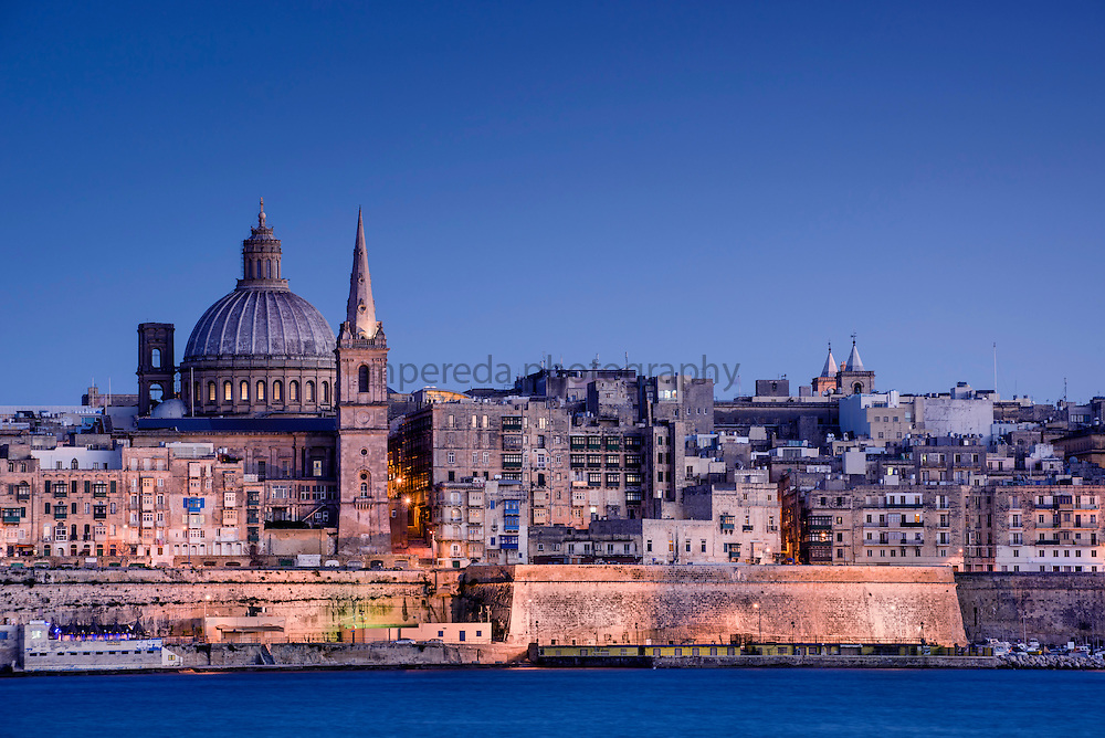View of Valleta from Sliema with the dome of Our Lady Of Mount Carmel Church and the bell-tower of St Paul's Cathedral.