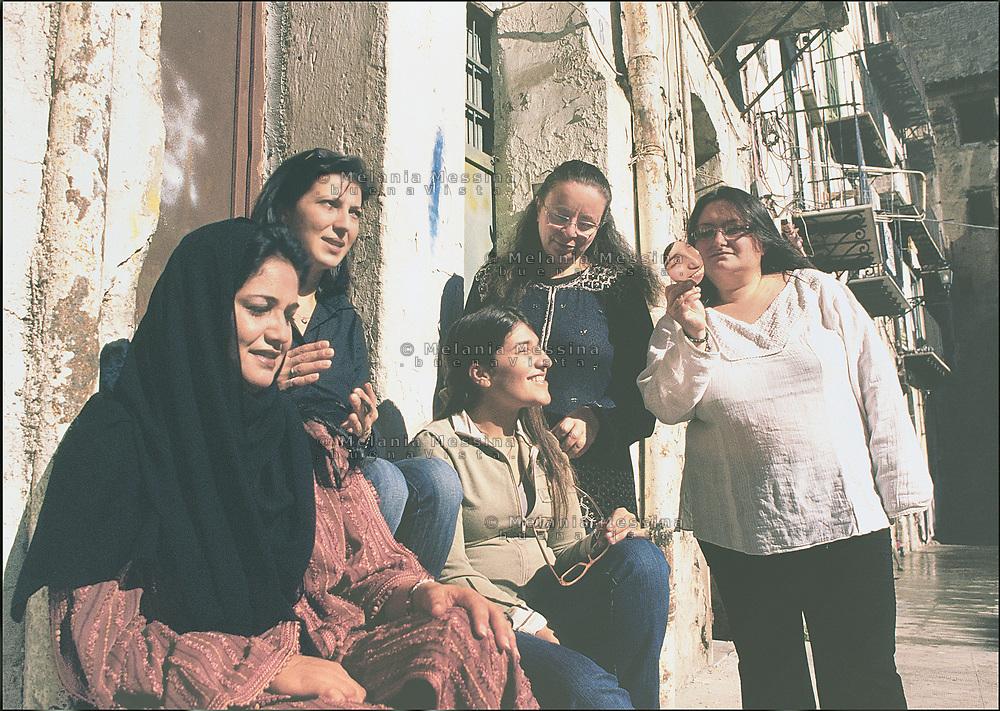 Women in the historical district of Ballaro' market in Palermo, they practice ethnic integration with immigrants community.<br /> Donne del quartiere dello storico mercato di Ballaro' a Palermo attuano pratiche di integrazione con le comunita' di immigrati.