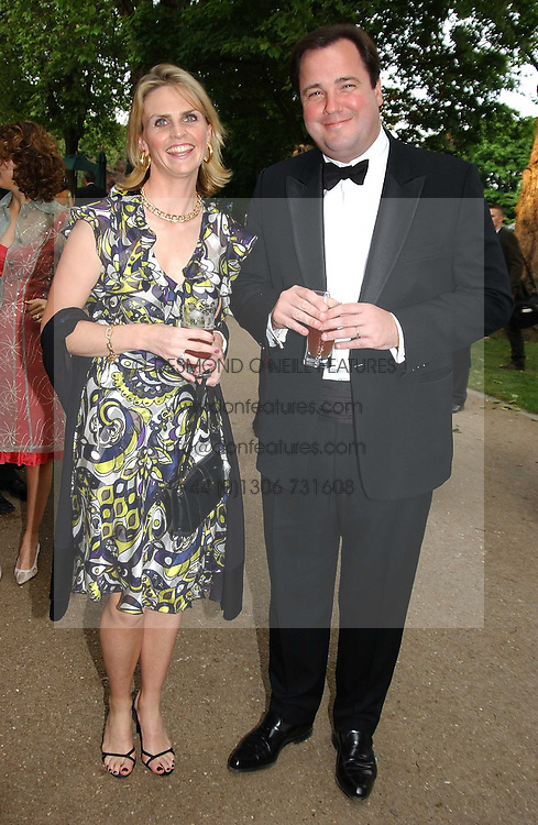 RUPERT &amp; LISA CHANNING at the Game Conservancy Jubilee Ball in aid of the Game Conservancy Trust held at The Hurlingham Club, London SW6 on 26th May 2005<br />