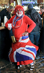 09 February 2016. New Orleans, Louisiana.<br /> Mardi Gras Day. Revelers in bright and colourful costumes fill the French Quarter. 'Union Jackie' props up the bar. <br /> Photo©; Charlie Varley/varleypix.com
