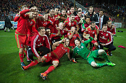 ZENICA, BOSNIA & HERZEGOVINA - Saturday, October 10, 2015:The Wales playes celebrate after securing a place at next years Euro Championships after the Bosnia & Herzegovina vs Wales match at the Stadion Bilino Polje during the UEFA Euro 2016 qualifying Group B match. (Pic by Peter Powell/Propaganda)