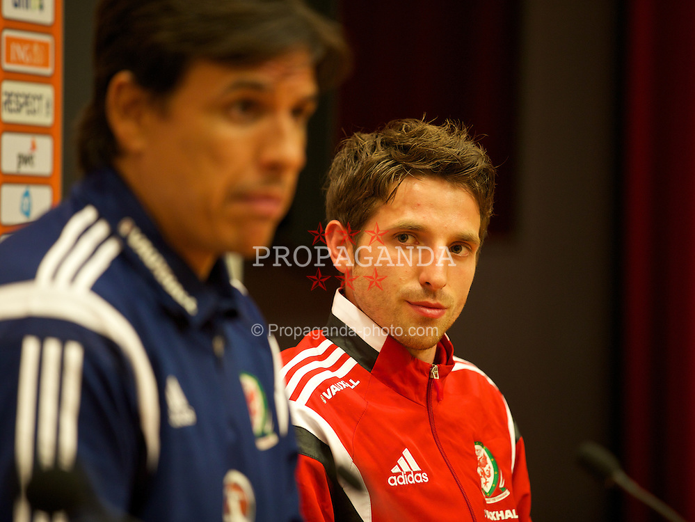 AMSTERDAM, NETHERLANDS - Tuesday, June 3, 2014: Wales' Joe Allen and manager Chris Coleman during a press conference at the Amsterdam Arena ahead of the International Friendly match against the Netherlands. (Pic by David Rawcliffe/Propaganda)