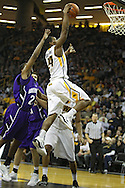 January 12 2010: Iowa Hawkeyes guard Bryce Cartwright (24) dunks the ball during the first half of an NCAA college basketball game at Carver-Hawkeye Arena in Iowa City, Iowa on January 12, 2010. Northwestern defeated Iowa 90-71.