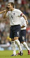 Photo: Aidan Ellis.<br /> England v Andorra. European Championships 2008 Qualifying. 02/09/2006.<br /> England captain John Terry shouts encouragment to his team mates