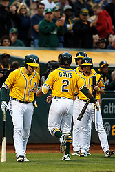OAKLAND, CA - JUNE 17:  Khris Davis #2 of the Oakland Athletics is congratulated by teammates after hitting a home run against the Los Angeles Angels of Anaheim during the fourth inning at the Oakland Coliseum on June 17, 2016 in Oakland, California. (Photo by Jason O. Watson/Getty Images) *** Local Caption *** Khris Davis