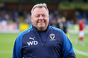AFC Wimbledon manager Wally Downes walking onto pitch during the Pre-Season Friendly match between AFC Wimbledon and Bristol City at the Cherry Red Records Stadium, Kingston, England on 9 July 2019.