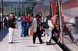 Passengers boarding train at Sitges railway station; Catalonia Catalunya,