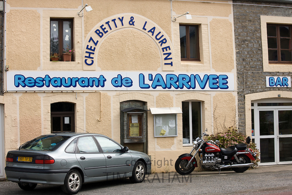 Renault Laguna saloon car and Honda Valkyrie motorcycle at Restaurant de l'Arrivee, in Normandy, France